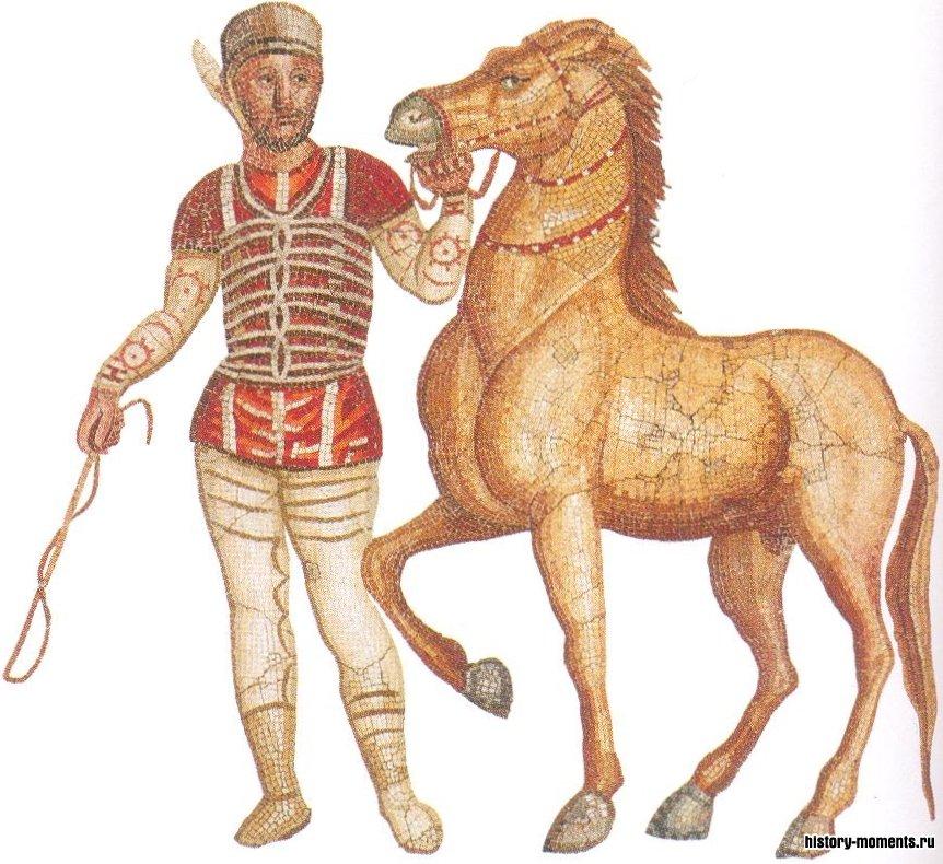Фрагмент римской мозаики, изображающей наездника-победителя и его коня. Колесницы мчались, огибая центральный барьер (спину), на каждом конце которого располагалось по три конических столба.
