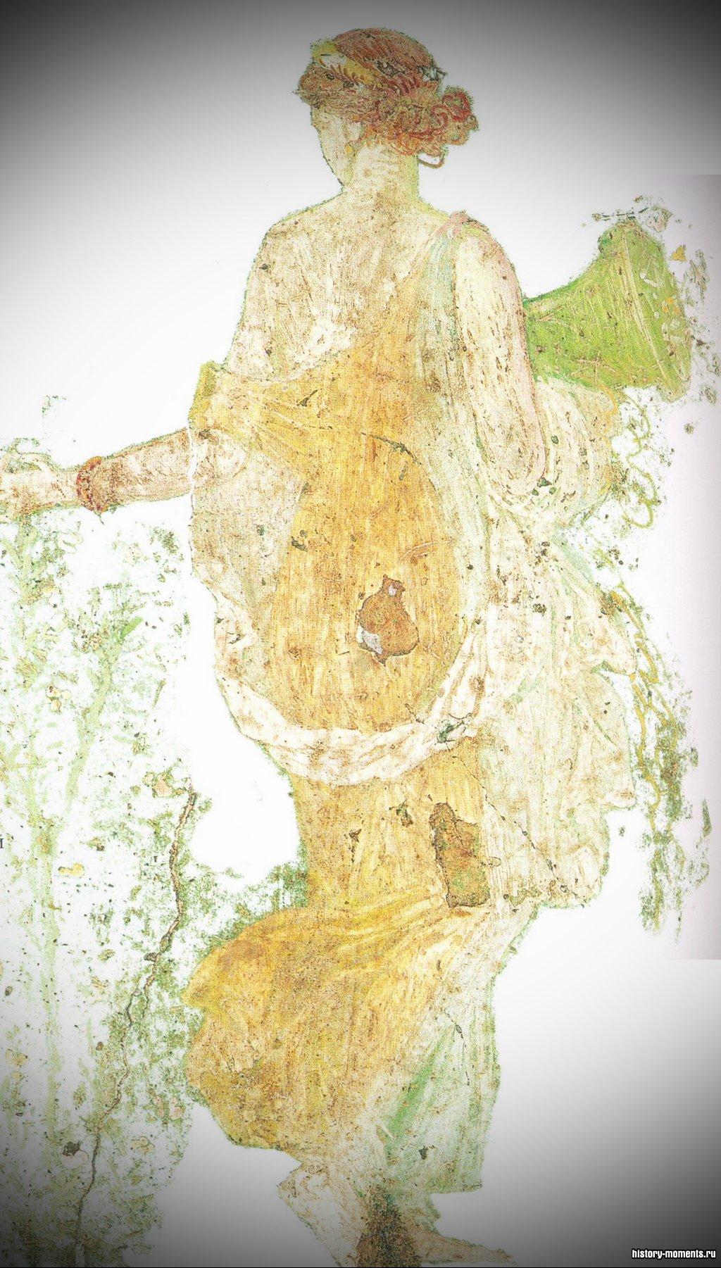 Римская фреска изображает богиню Флору, собирающую цветы.